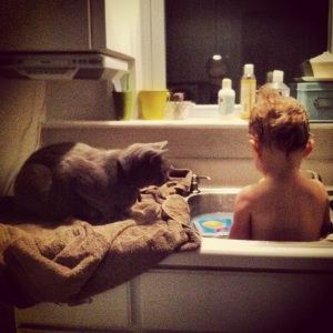 Aside from playing and singing, bath time sometimes involves a special (feline) guest.