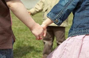 Kids holding hands on playground