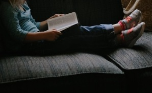 kid reading on couch